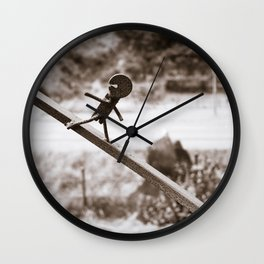Metal Figure Walking Down Wall Clock