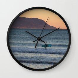 Surfer at sunset Wall Clock