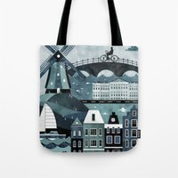 travel poster Tote Bags featuring Amsterdam Travel Poster by ClaireIllustrations