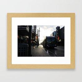 Bussing through Downtown Framed Art Print