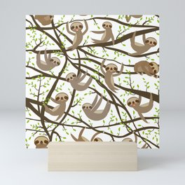 funny and cute smiling Three-toed sloth on green branch tree creeper Mini Art Print