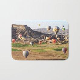 Hot air balloons flying over Cappadocia Bath Mat