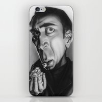 nicolas cage iPhone & iPod Skins featuring Nicolas Cage with popcorn. by Patrick Dea