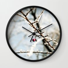 Frozen branch with red berry Wall Clock