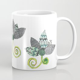 Spring Sprung by Sandy Thomson. Montage floral pattern, black & white with greens. Coffee Mug