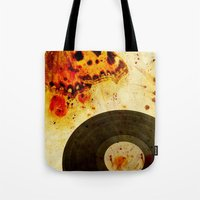 moth Tote Bags featuring moth by Markus Breitbach