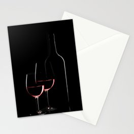 Red wine bottle and two wine glasses on black background on black background Stationery Cards