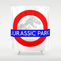jurassic park Shower Curtains featuring LONDON UNDERGROUND : JURASSIC PARK STATION by DrakenStuff+
