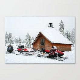 Winter wonderland, log cabin, skidoos, Finland Canvas Print