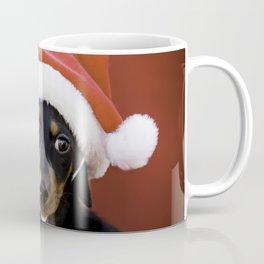 Christmas Dachshund Puppy Wearing a Santa Hat with Poinsettias Coffee Mug