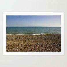 Evening Tide on a cobbled beach Art Print