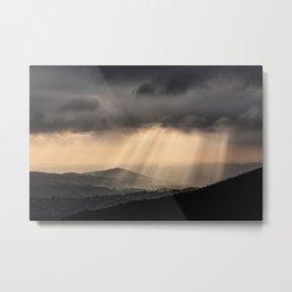 Sunbeams illuminate the hills below Metal Print