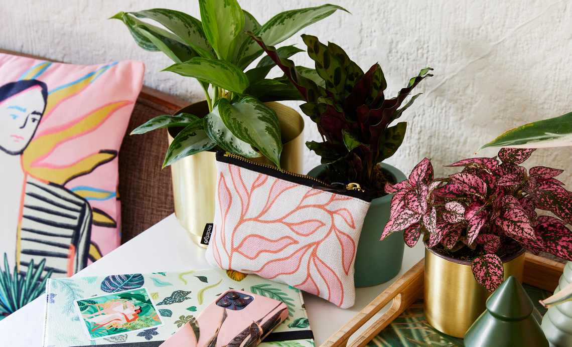 credenza with plant patterned pouch, phone case, sticker and throw pillow