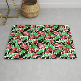 Abstraction red cherry berry broken green leaves black background Rug