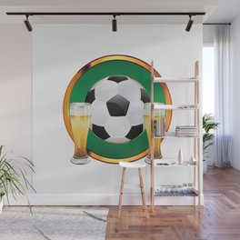 Two beer glasses and soccer ball in green circle Wall Mural