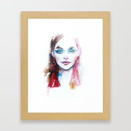 Woman with pink earrings Framed Art Print