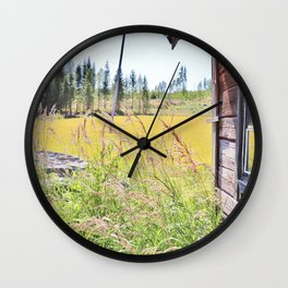 Late summer field view with old log cabin Wall Clock