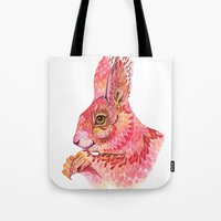 squirrel Tote Bags featuring The squirrel magic  by Ola Liola