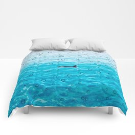 Orca Whale gliding through the water on a rainy day Comforters