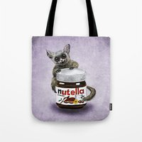 nutella Tote Bags featuring Sweet aim // galago and nutella by Anna Shell