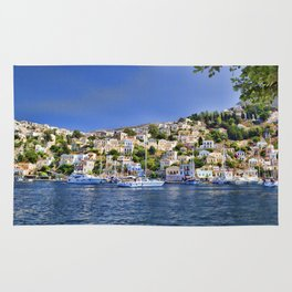 Symi island in Greece. Traditional houses. Sunny day with blue sky and sea. Rug