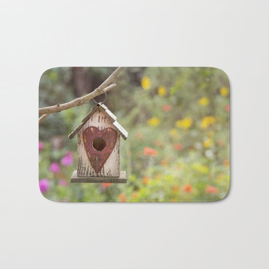 bird house in summer garden Bath Mat
