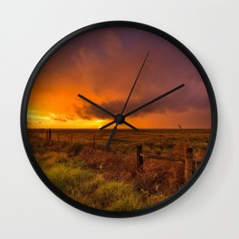 Sunset on the Plains - Sun Illuminates Sky After Stormy Day Wall Clock
