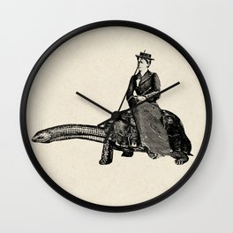 Riding a snake turtle Wall Clock