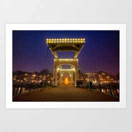 Skinny bridge at the Amstel river in Amsterdam by night. Art Print