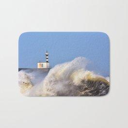 Stormy wave over lighthouse of San Esteban de Pravia. Bath Mat