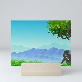 girl seating under tree Mini Art Print