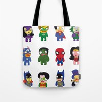 superheroes Tote Bags featuring superheroes by Manola  Argento