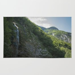 A small waterfall in the mountains Rug