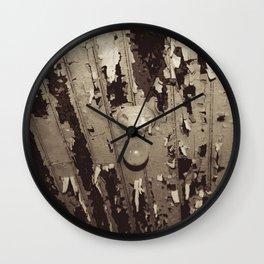 Peeling Ceiling with Lightbulb Wall Clock