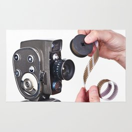 Retro mechanical hobbies movie camera and film in hands Rug