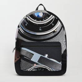 Vintage camera and films on black Backpack