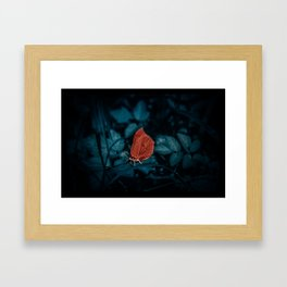 Red in the dark Framed Art Print