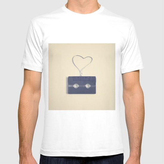 Retro black music cassette and heart shaped tape on beige background T-shirt
