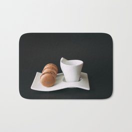 Set of cup of coffee and macaroons against black background Bath Mat
