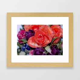 Snow settling on a top of Bouquet of flowers Framed Art Print