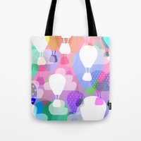 hot air balloons Tote Bags featuring Hot air balloons by Ingrid Castile