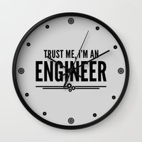 engineer Wall Clocks featuring Trust Me Engineer Quote by EnvyArt