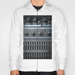 Color image of many buttons in a sound recording studio. Hoody