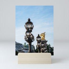 Art Nouveau lamps on Pont Alexandre III - Paris, France Mini Art Print