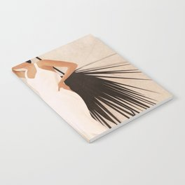 Minimal Woman with a Palm Leaf Notebook