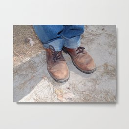 Boots on the ground of the foot Metal Print