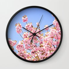 Pink Cherry Blossoms Against Blue Sky Wall Clock