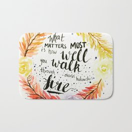 """Charles Bukowski quote """"What matters most is how well you walk through fire."""" Bath Mat"""