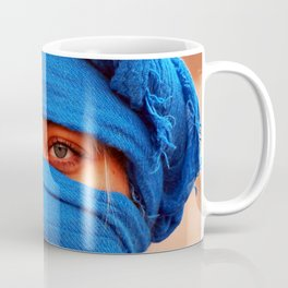 A portrait of a blue eyes lady with a blue desert scarf around her head in Egypt Coffee Mug