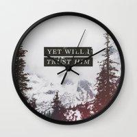 pocketfuel Wall Clocks featuring YET WILL I TRUST by Pocket Fuel